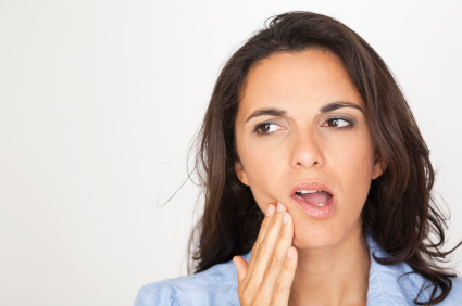 Woman in need of gum disease treatment in Seattle, WA.